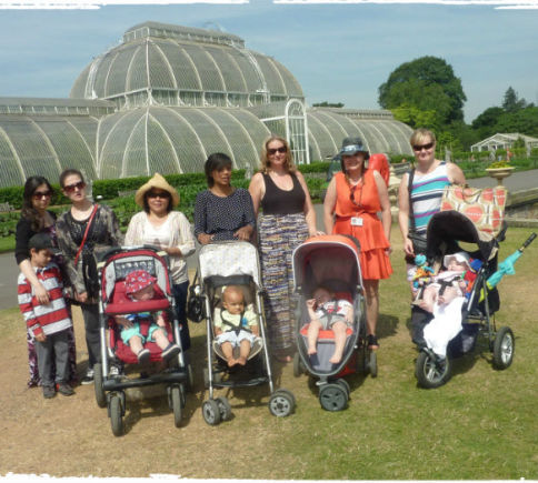 Mums with their buggies on a sunny outing to Kew Gardens in Richmond