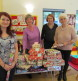 Volunteers wrapping Christmas presents for disadvantaged children at our East Surrey centre