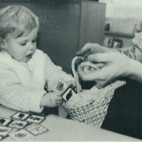 Old black and white photo of young child playing