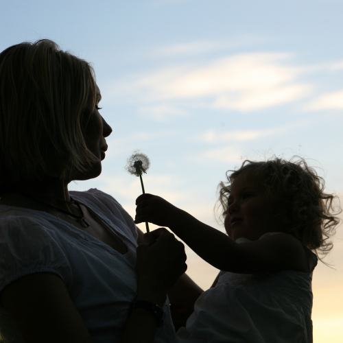 Silhouette of mum & baby daughter