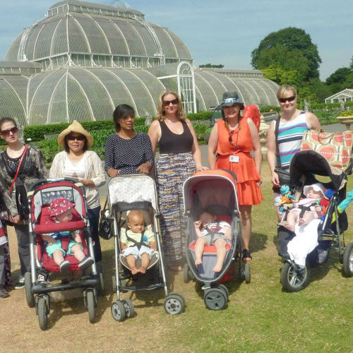 Staff, parents and children visiting Kew Gardens